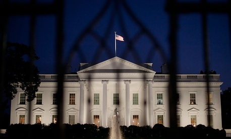 The White House in Washington is seen at night, Monday, Sept. 30, 2013.