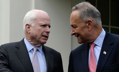 Sen. John McCain, R-Ariz., left, and Sen. Charles Schumer, D-N.Y., walk to talk with reporters outside of the West Wing of the White House in July.