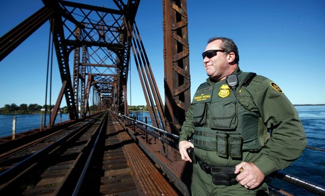 Senior Border Patrol Agent Sheldon Cooper monitors the International Railroad Bridge in Buffalo, N.Y.