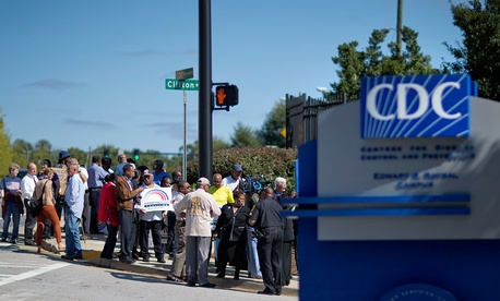 Federal workers demonstrate against the government shutdown outside the Centers for Disease Control and Prevention, Tuesday, Oct. 8 in Atlanta.