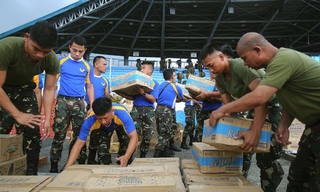 Philippine soldiers pack relief supplies for victims of Typhoon Haiyan at Villamor Airbase.