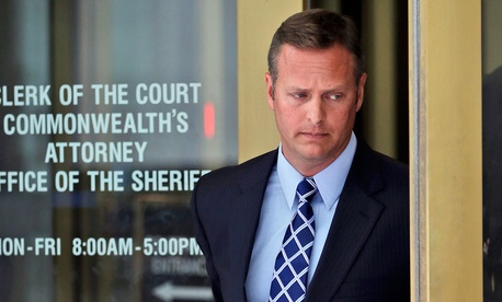 Lt. Col. Jeffrey Krusinski, who led the Air Force's Sexual Assault Prevention and Response unit, is seen leaving the Arlington County General District Court, Thursday, July 18, 2013.