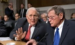 Senate Armed Services Committee Chairman Sen. Carl Levin, D-Mich., left, talks with the committee's ranking Republican, Sen. James Inhofe, R-Okla.