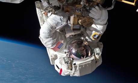 Astronaut Chris Cassidy performs a space walk on the International Space Station
