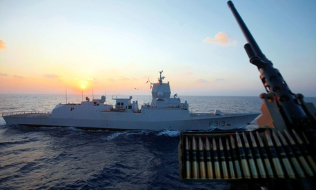 "The Norwegian warship ""Helge Ingstad"" passes by the Danish warship Esbern Snare during a sunset at sea between Cyprus and Syria, Sunday, Jan. 5, 2014."