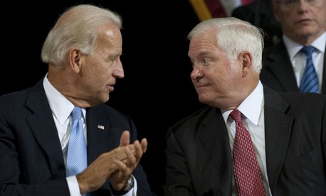 Robert Gates and Joe Biden sat together during the United States Forces-Iraq change of command ceremony in 2010