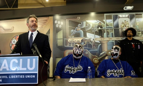 Michael J. Steinberg, legal director for the ACLU of Michigan addresses the media as members of the Insane Clown Posse listen in Detroit.
