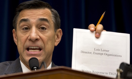 Rep. Darrell Issa, R-Calif., holds up a document as he speaks to IRS official Lois Lerner on Capitol Hill in May.