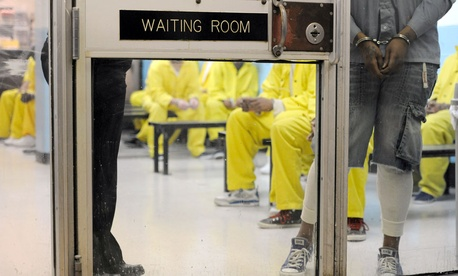 Detainees wait in a waiting room at a medical unit at Baltimore City Detention Center in Baltimore.