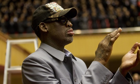 Dennis Rodman claps as he watches basketball in North Korea on Jan. 8.