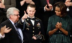 Army Ranger Sgt.1st Class Cory Remsburg acknowledges applause from first lady Michelle Obama and others during President Barack Obama's State of the Union address.