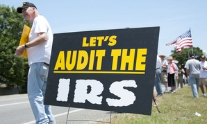 Tea Party protesters rally in front of local IRS in Florida in May.