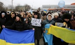 "Crimean Tatars shout slogans and hold banner which reads: ""No War"" during the pro-Ukraine rally in Simferopol, Crimea, Ukraine, Monday, March 10, 2014."