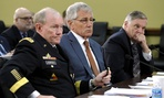 Joint Chiefs Chairman Gen. Martin Dempsey, left, Defense Secretary Chuck Hagel, center, and Robert Hale Undersecretary of Defense Comptroller.