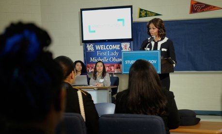 Michelle Obama speaks to students at T.C. Williams High School in Alexandria, Va.,  in February, during a workshop to help students fill out the Free Application for Federal Student Aid.