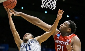Xavier's Dee Davis shoots against North Carolina State's Beejay Anya in the first round of the NCAA tournament Tuesday.