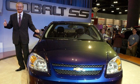 Gary Cowger, president of GM North America, stands beside a new 2005 Chevrolet Cobalt in 2003.