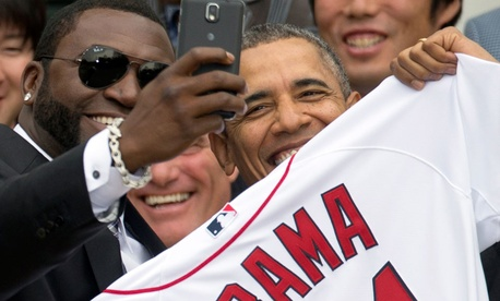 "Boston Red Sox designated hitter David ""Big Papi"" Ortiz takes a selfie with President Barack Obama during a ceremony on the South Lawn of the White House."