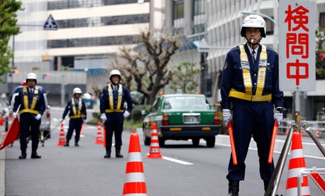 Policemen stand in front of the U.S. Embassy in Tokyo, Tuesday, April 22, 2014. Security has been increased in the Tokyo metro area a day before U.S. President Barack Obama arrives.