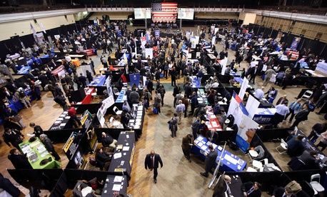 Veterans, military spouses, and transitioning service members meet with employers at the U.S. Chamber of Commerce Foundation's Hiring Our Heroes job fair on March 27, 2014 in New York.