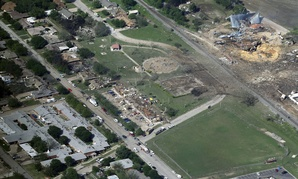 The remains of a nursing home, left, apartment complex, center, and fertilizer plant, right, destroyed by an explosion at a fertilizer plant in West, Texas.