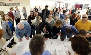 Job seekers line up for a job fair at Columbia-Greene Community College in Hudson, N.Y.