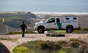 An agent leaves vehicle to conduct a foot patrol of an area near San Diego.