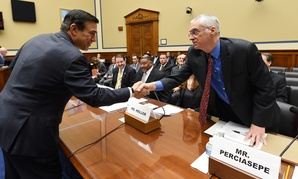 Rep. Darrell Issa, R-Calif., greets Bob Perciasepe, EPA deputy administrator, before the House Oversight and Government Reform full committee hearing on Wednesday.