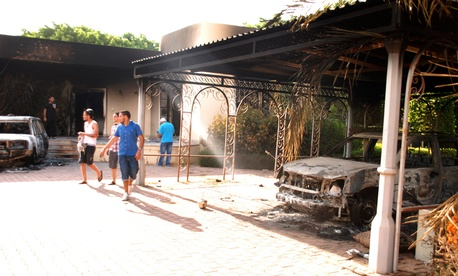Libyans walk on the grounds of the gutted U.S. consulate in Benghazi in 2012.