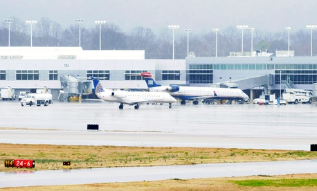 A United Express jet operated by ExpressJet pulls into the terminal after landing in rain on the main runway at Birmingham-Shuttlesworth International Airport.