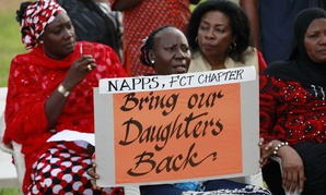Women attend a sit down rally calling on the government to rescue the kidnapped school girls of the Chibok secondary school, in Abuja, Nigeria, on May 15.