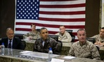 President Barack Obama, center, gets a briefing after arriving at Bagram Air Field for an unannounced visit.