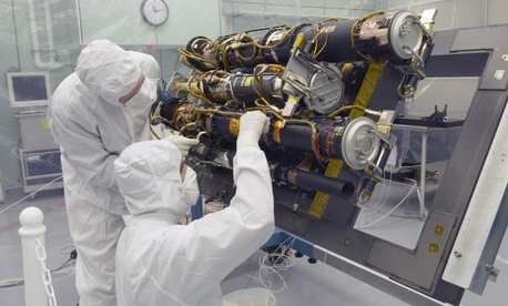 Researchers work in the  Sun Earth Connection Coronal and Heliospheric Investigation (SECCHI) instrument being built at the Naval Research Laboratory in Washington, DC