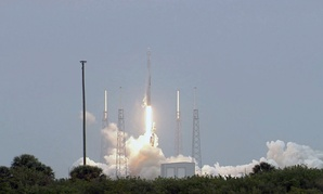 The SpaceX-3 mission soars into the clouds over on Cape Canaveral Air Force Station aboard a Falcon 9 rocket in April.