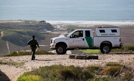 Border agents patrol a beach in 2012.