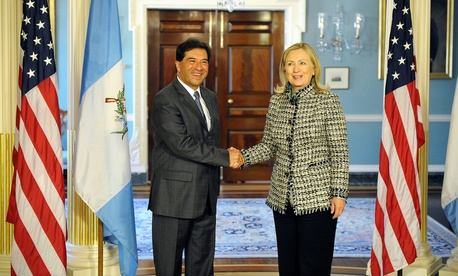 Happier times: Hillary Rodham Clinton shakes hands with Guatemalan Foreign Minister Harold Caballero as Secretary of State in 2012