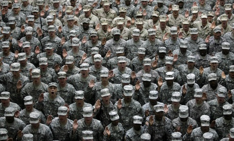 U.S. military service members take an oath at a mass re-enlistment ceremony in Baghdad, Iraq.