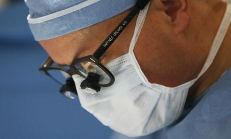 Dr. Raffaele Girlanda, leads a team of surgeons during a transplant at Georgetown University Hospital