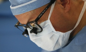 Dr. Raffaele Girlanda, leads a team of surgeons during a transplant at Georgetown University Hospital