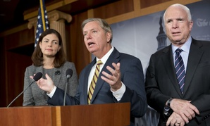 Sen. John McCain, R-Ariz., right, the ranking member of the Senate Armed Services Committee, right, joined by Sen. Lindsey Graham, R-S.C., center, and joined by Sen. Kelly Ayotte, R-N.H., left,