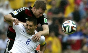 Germany's Per Mertesacker, back, and United States' Clint Dempsey go for a header during the World Cup.