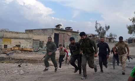 ree Syrian Army fighters running at one of the front lines in the town of Sheikh Najjar, in Aleppo, Syria.