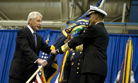 U.S. Defense Secretary Chuck Hagel passes the Strategic Command flag to Navy Adm. Cecil Haney during a change-of-command ceremony in 2013.