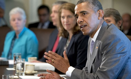 President Barack Obama speaks to the media during a meeting with his cabinet members in the Cabinet Room of the White House.
