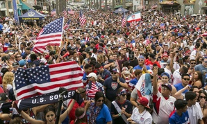 U.S. soccer fans react as they watch the telecast of the 2014 Brazil World Cup match between the United States and Germany.