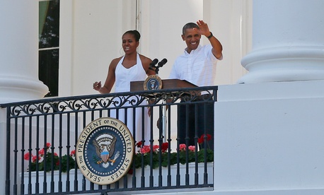 The Obamas greet military families as they host an Independence Day celebration Friday.