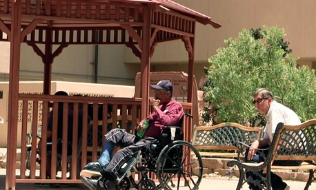 Men sit outside the Raymond G. Murphy VA Medical Center in Albuquerque, N.M., Thursday, July 3, 2014.