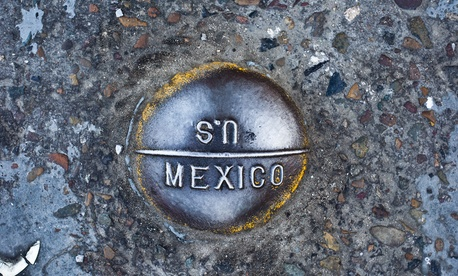 A marker notes the international border at San Ysidro.