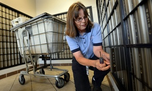 U.S. Postal employee Susan Barry changes the lock on one of the over 8,000 post office boxes at the University of Mississippi Post Office.