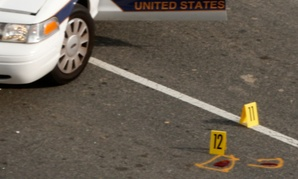 Evidence markers are placed near a Capitol Police vehicle following a shooting last October.
